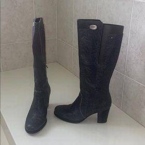 Gray textured Ugg heeled boots.